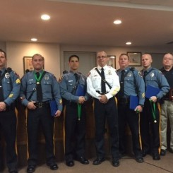 Five Pequannock police officers and a police dispatcher were recognized Tuesday, Nov. 24 for their heroic efforts last month to save the victim of a fiery fatal crash. Pictured left to right: Sgt. Robert Brown, Patrol Officer Kenneth Hunt, Patrol Officer Kevin Ricciardi, Chief Brian Spring, Patrol Officer Jack Lyon, Patrol Officer Christopher Nelson and Dispatcher Jerome McMahon. (Photo credit: Pequannock Police Department)